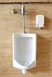 Close-up white urinals in men's public restroom. Stock Image