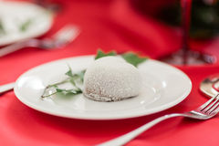 Close up white wedding cake on the red wedding table. Stock Photo