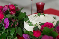 Close up white wedding cake and table decorated with flowers. Stock Photography