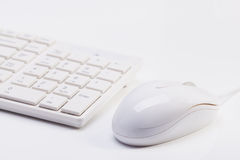 Close up of white wireless keyboard  and wired mouse Stock Photos