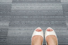 White women high heel shoes on office carpet royalty free stock images
