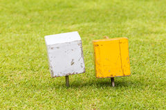 Close-up white and yellow color wooden tee off area or tee box w Royalty Free Stock Images