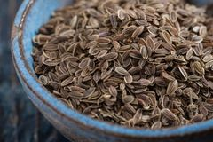 A bowl of dill seeds royalty free stock photography