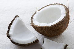 Close up of whole raw coconut cracked open Royalty Free Stock Photography