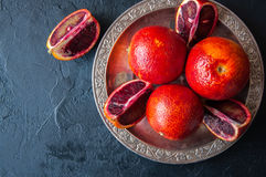Close up of whole and slices of fresh and ripe blood oranges in Stock Image