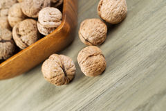 Close up of Whole Walnuts on Faded Wood Stock Images