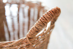 Close up of wicker basket on white background.  Stock Photo