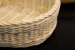 Close-up of a wicker basket on a white background. With shallow Royalty Free Stock Image