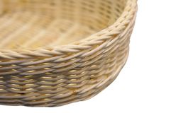 Close-up of a wicker basket on a white background. With shallow Stock Image