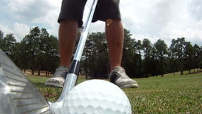Close-up wide-angle view of golf ball being hit stock video footage