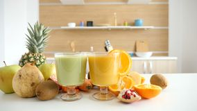 Close up wide footage of two glasses with healthy organic juices. At the kitchen stock video