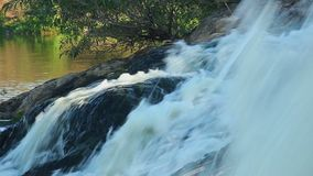Close-up wild water torrent running down the slope into river. Stock footage stock video footage