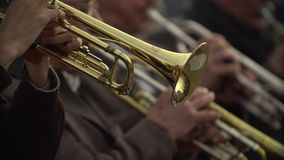 Close-up of wind instruments. Jazzman plays the trumpet. Brass tool. 4K stock video footage