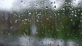 Window rain speed train road. Close up of window glass with rain drops high speed train stock footage
