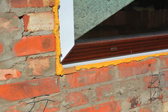 Close up on window insulation with spray foam insulation. Windows installation Stock Photo