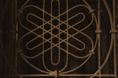 Close up of a window with metal lattice. Rust on the lattice Stock Photo