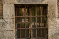 Close up of a window with metal lattice. Rust on the lattice Royalty Free Stock Image