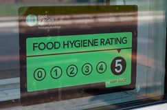 Close up of a window sticker indicating a maximum food hygience rating of 5 Widnes April 2019. Close up of a window sticker showing a maximum food hygience royalty free stock photo