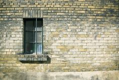 Close up of a window on weatherd brick wall Royalty Free Stock Photo