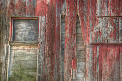Close up of the windows on an old red barn Stock Photography