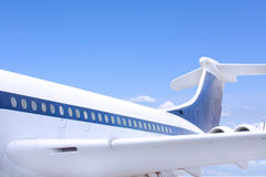 Close up of windows and tail fin plane Royalty Free Stock Photo