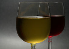 Close up of wine. Close up of chilled white and red wine, backlit on dark background Royalty Free Stock Photo