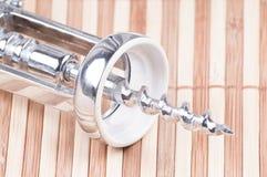 Close up wine bottle opener. On bamboo background Royalty Free Stock Photo