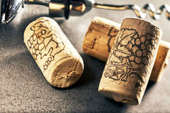 Close up of wine corks and corkscrew. Close up of three wine corks and corkscrew in background Stock Photos