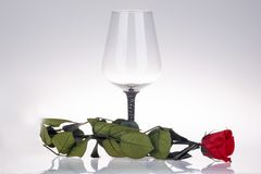 Close-up of wine glass with red rose Royalty Free Stock Photo
