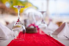 Close-up of wine glass on the set table for Stock Image