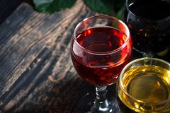 Close-up of wine glasses on a wooden background, top view. Horizontal royalty free stock photography