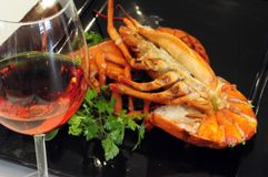 Close-up of wine and lobster. A close-up picture of a glass of wine and lobster stock photo