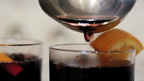 Close up wine poured into a glass. Cooking traditional drink for Christmas. Mulled wine preparations. Close up stock video