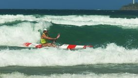Close up of the winner of a men`s surf ski race. Close up of the winner of a surf life saving men`s surf ski race on the sunshine coast of australia stock video