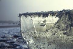 Close-up winter macro shot of an ice block on a frozen lake. Stock Photo