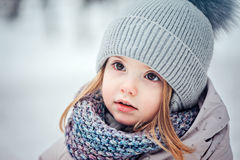 Close up winter portrait of adorable toddler girl in snowy forest Stock Images