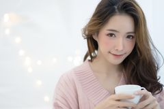 Close-up winter portrait of young Asian beautiful woman wearing stock photos