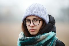 Close up winter portrait young cute brunette girl strolling winter forest park. stock images