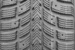 Close-up winter tire tread. Textured tire tread. Part of brand new modern winter car tire.  royalty free stock photography