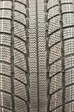 Close-up winter tire tread. Textured tire tread. Part of brand new modern winter car tire. vertical photo.  stock image