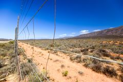 Close up of a wire mesh border fence near the town of Prince Albert in the Swartberg Mountain range Royalty Free Stock Photography