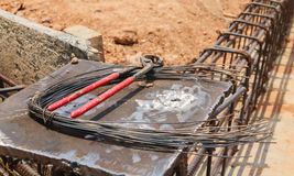 Close up of a wire and nipper. Contaminated soil put on steel plate Stock Images