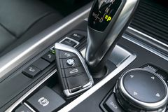 Close up of wireless keys of BMW X5 F15 2017 in black leather car interior. Modern Car interior details. Royalty Free Stock Photos