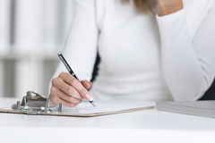 Close up of woman's hand with a pen Stock Images