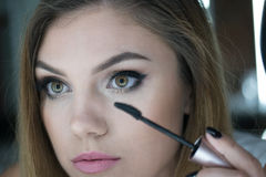 Close Up of Woman Applying Make Up Royalty Free Stock Images