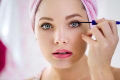 Close up of woman applying mascara Stock Images