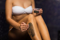 Close up of woman applying therapeutic mud in spa Stock Photos