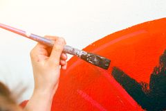 Woman paint little car royalty free stock photography