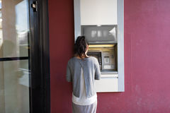 Close up of woman at atm machine outdoors Stock Photos