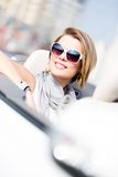 Close up of woman in the automobile Royalty Free Stock Image